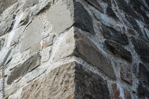Photo Old stone corner wall.