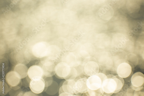 Foto Bright, golden bokeh orbs as a source of graphic design background