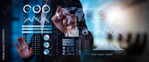 Fotografering Investor analyzing stock market report and financial dashboard with business intelligence (BI), with key performance indicators (KPI)