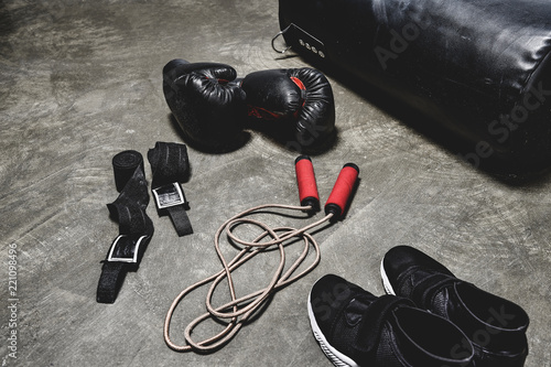 Wallpaper Mural various boxing equipment lying on concrete surface