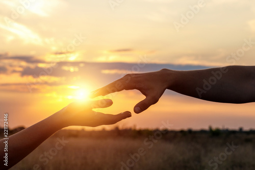 Hands reach for each other .