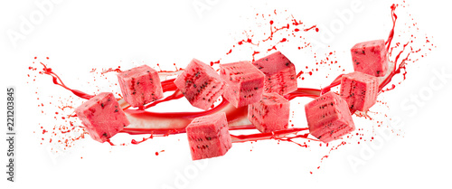 watermelon cubes in juice splash isolated on a white background