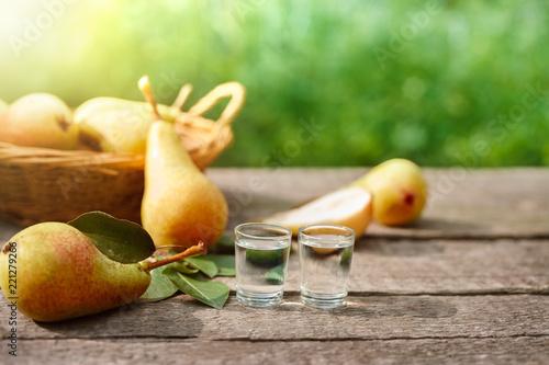 Homemade fruit peer brandy in shot glass