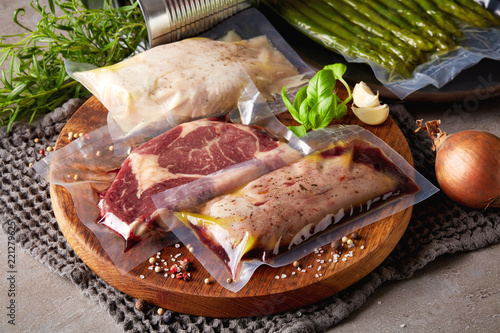 Meat vacuum sealed on stone table