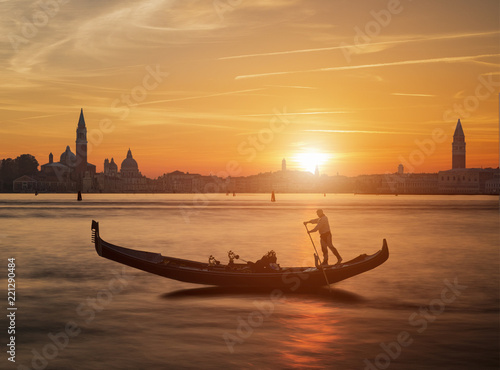 Fotografie, Tablou Gondola and the sunset in Venice Italy