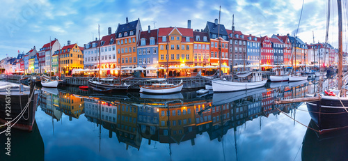 Canvas Print Panorama of north side of Nyhavn with colorful facades of old houses and old ships in the Old Town of Copenhagen, capital of Denmark