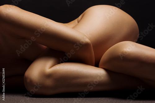 Beautiful female body part on black background.