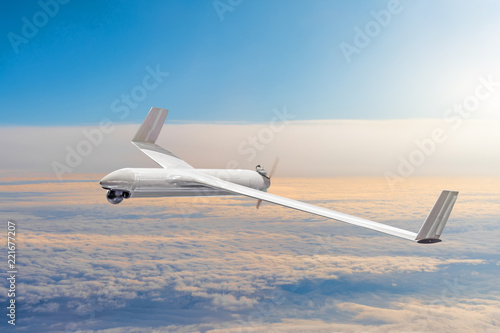 Unmanned military drone on patrol air territory at high altitude.