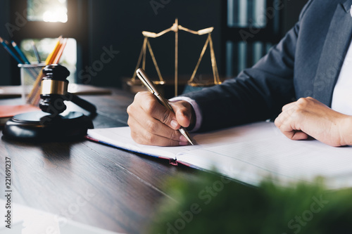 Photographie Judge gavel with Justice lawyers, Business woam in suit or lawyer working on a documents