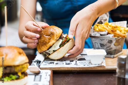Girl eating burger in the restaurant