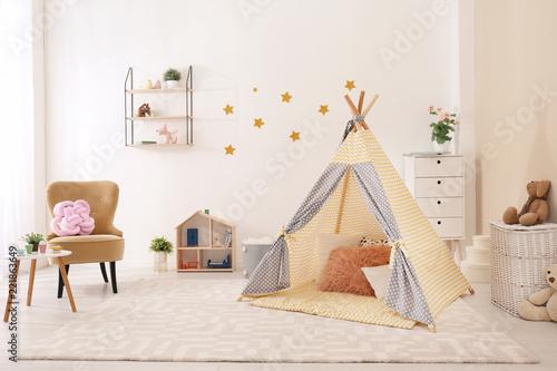 Obraz na płótnie Cozy kids room interior with play tent and toys