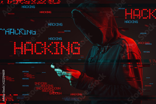 Computer hacking concept with faceless hooded male person Fototapeta