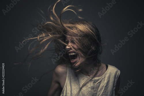 Crazy, deranged young woman screaming with frustration, expressing madness and r Poster Mural XXL