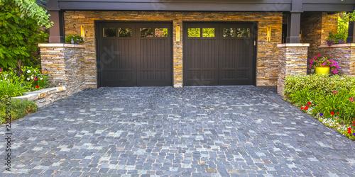 Photo Brick stone driveway double garage doors pano