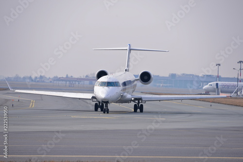 This is a view of LOT-Polish Airlines plane Bombardier CRJ-900 registered as ES-ACJ on the Warsaw Chopin Airport Fototapet