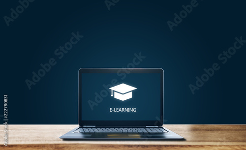 E-learning on computer laptop, on wooden table. Online education, e-learning, e-book and education media concept