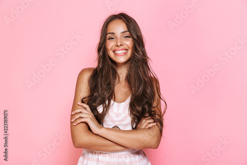 Photo Image of european lovely woman 20s with long hair wearing dress smiling at you w