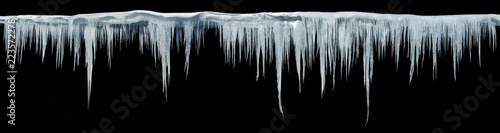 Fotografia Icicles on an black background, isolated object. Panoramic photo.