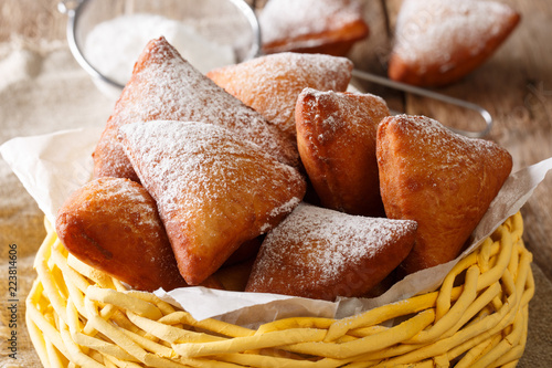 Mandazi is a slightly sweet East African Street Food; spicy, airy yeast doughnut dough made with coconut milk, flavored with cardamom