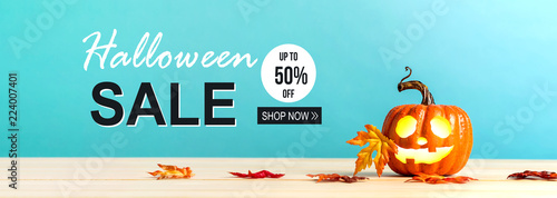 Halloween sale message with pumpkin with leaves on a blue background