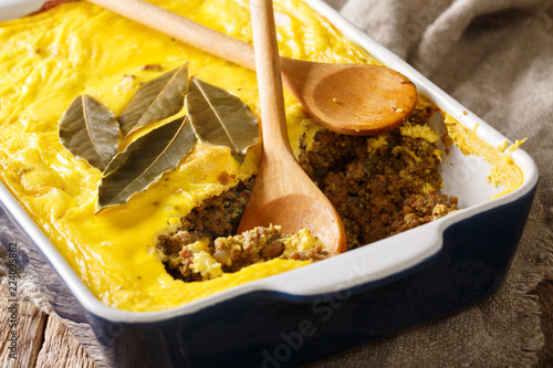 South African traditional food Bobotie baked curry ground meat with whipped eggs close-up. horizontal
