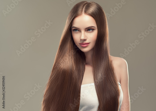 Wallpaper Mural Beautiful long hair smooth woman with perfect hairstyle young model