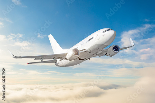 Passenger aircraft cloudscape with white airplane is flying in the daytime sky overcast.