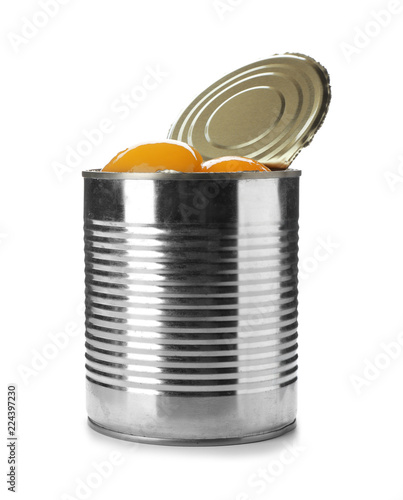 Tin can with conserved peach halves on white background