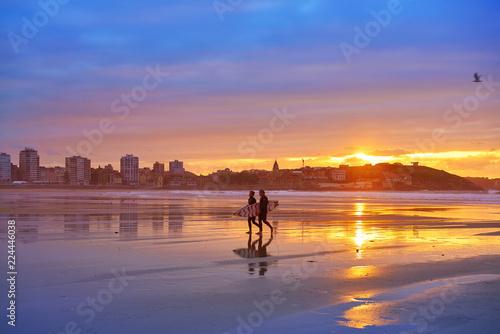 Gijon sunset San Lorenzo beach surfers in Asturias