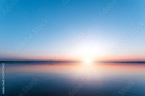 Obraz na plátne Beautiful, red dawn on the lake