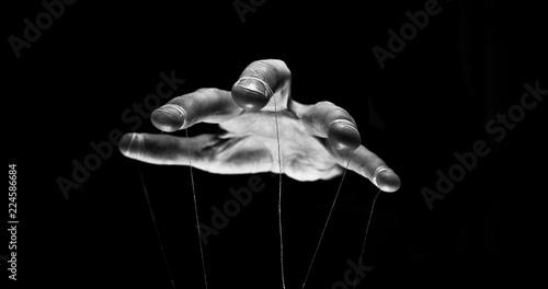 Fotografie, Obraz Eerie puppeteer hands controlling you. Manipulation concept