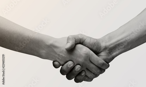 Photo Business agreement handshake on white background. Black and