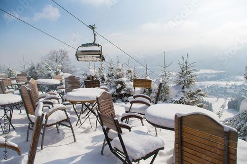Outdoor mountain cafe in winter season,  Poland, ski resort Zakopane, Polana Szymoszkowa, mountains of Polish Tatras
