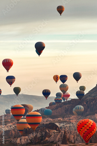 Canvas Mountain landscape with large balloons in a short summer season at dawn