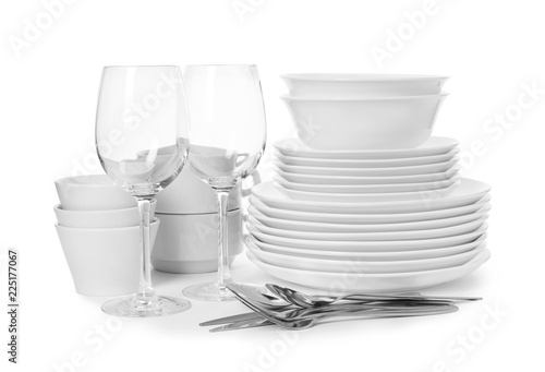 Set of clean tableware on white background. Washing dishes