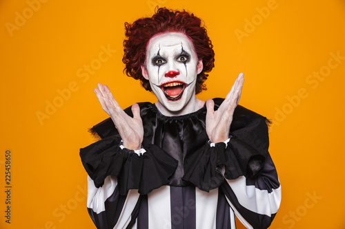 Funny clown looking camera with happiness isolated Fototapet