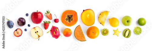 Creative layout made of fruits. Flat lay. Plum, apple, strawberry, blueberry, papaya, pineapple, lemon, orange, lime, kiwi, melon, apricot, pitaya and carambola on the white background.
