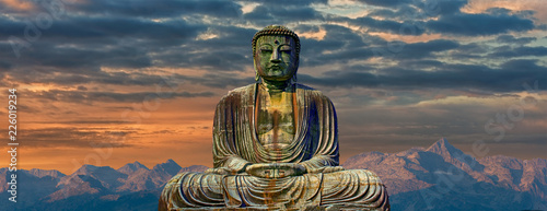 Leinwand Poster Image of buddha with mountains at dawn background
