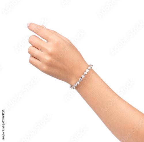 Fototapeta bracelet inlaid with gemstones on hand isolated on white background