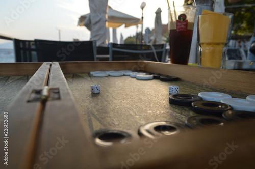 Fotografiet backgammon on the coffee table