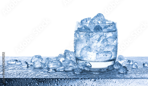 Valokuva Water with crushed ice cubes in glass on white background