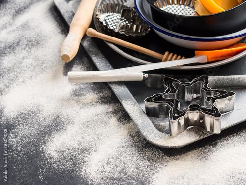 Baking utensils and accessories, cake tins. Christmas dark background