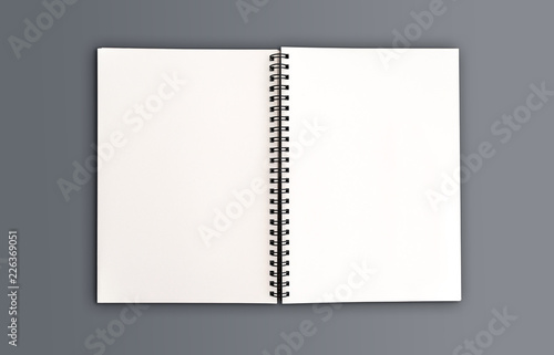 top view of blank open spiral note pad on desk