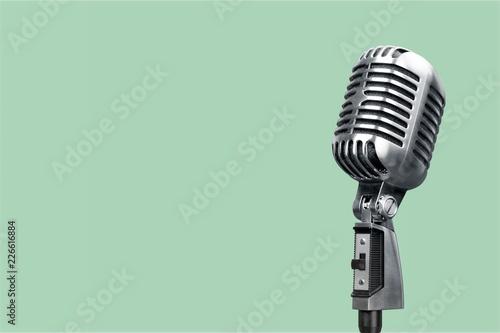 Retro style microphone on background Fototapeta