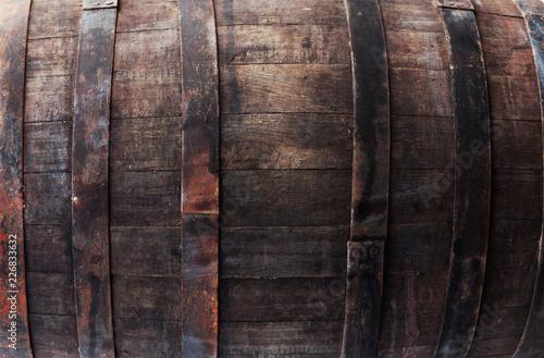 Old brown oak barrel with rivets closeup