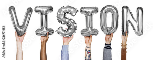 Gray silver alphabet helium balloons forming the text vision