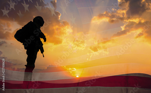 Canvas Print Double exposure Silhouette of Soldier on the United States flag in sunset for Veterans Day is an official USA public holiday background,copy space