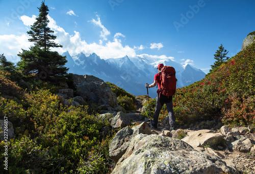 Fotografiet A man hiking on the famous Tour du Mont Blanc near Chamonix, France