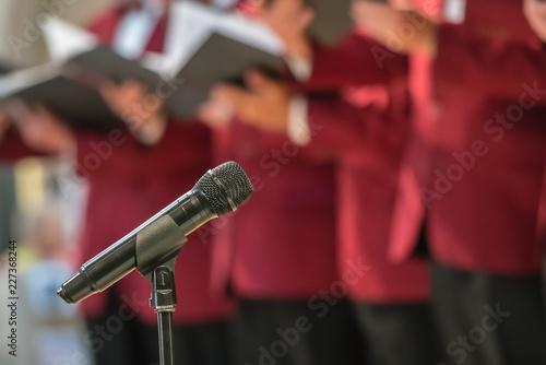 Obraz na plátne Microphone and mens choir