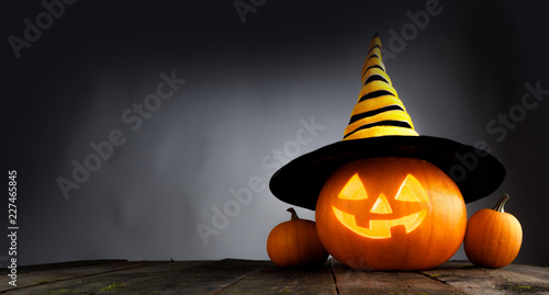 Halloween pumpkin with witches hat